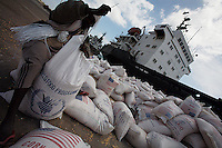 United States World food Program food supplies arrive at the Mogadishu port in Somalia on Saturday Dec 30 2006..Although the aid was delivered for the Sept- Nov floodings large quantities of it are still blocked because of the war.. Only a few days after the fall of the United Islamic Courts in Mogadishu, Ethiopian and Transitional Federal Government troops are patrolling the city and securing strategic locations..The people in Mogadishu appear confused and doubtful on t