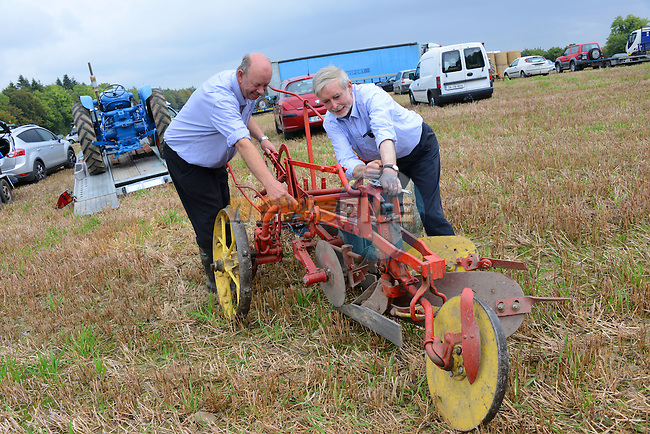 Thomas Rowland and Pat Fullam get to grips with an old plough at the Meath Vintage Group's ploughing Day at Townley Hall.