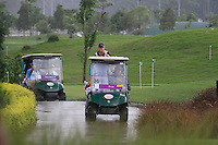 A fleet of buggies ferry players and caddies back to the clubhouse as the heavens open yet again as monsoon rains fall during Saturday's storm delayed  Round 3 of the Iskandar Johor Open 2011 at the Horizon Hills Golf Resort Johor, Malaysia, 19th November 2011 (Photo Eoin Clarke/www.golffile.ie)