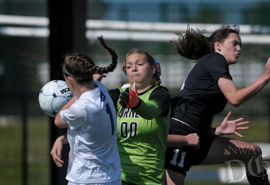 NWA Democrat-Gazette/BEN GOFF @NWABENGOFF<br />  , Bryant goalkeeper grabs the ball off of a corner kick between teammate Mary Catherine Selig (1) and Lauren Hargus (11) of Bentonville on Saturday May 14, 2016 during the girls soccer class 7A state semifinal game at Springdale Har-Ber's Wildcat Stadium.