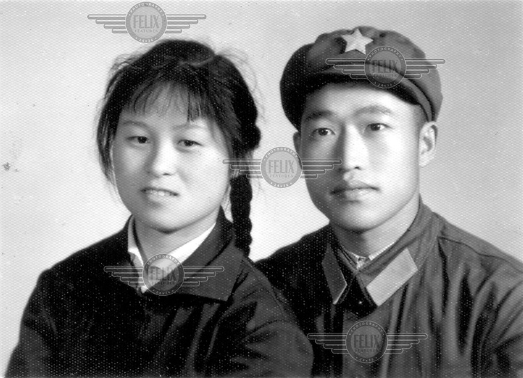 An example of the type of wedding photograph taken in China in the 1950s and 1960s, during the cultural revolution when standard proletariat portraits of couples dressed in Mao suits were the accepted form of marriage memento.