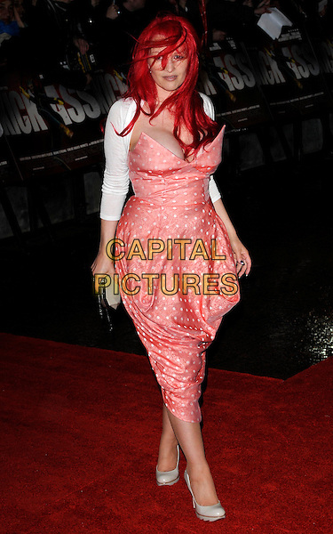 JANE GOLDMAN.'Kick-Ass' UK film premiere, Empire cinema, Leicester Square, London, England, UK..March 22nd, 2010.arrivals full length cleavage pink peach polka dot strapless Vivienne Westwood dress white shrug low cut cream shoes heels dyed red messy hair in face .CAP/CAN.©Can Nguyen/Capital Pictures.