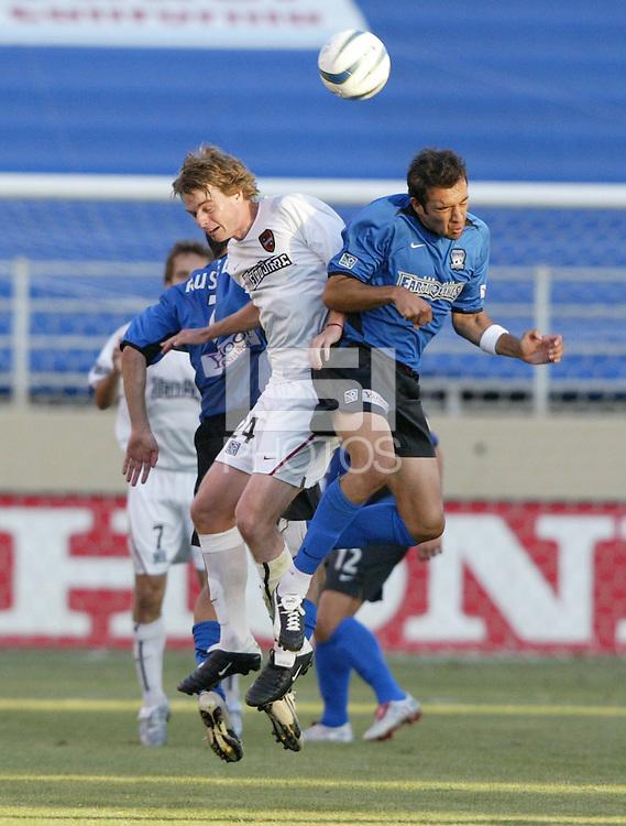12 June 2004: Earthquakes Ramiro Corrales battles for the ball in the air against MetroStars Midfielder Eddie Gaven at Spartan Stadium in San Jose, California.    Earthquakes defeated MetroStars, 3-1.   Mandatory Credit: Michael Pimentel / ISI