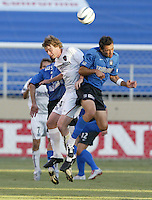 12 June 2004: Earthquakes Ramiro Corrales battles for the ball in the air against MetroStars Midfielder Eddie Gaven at Spartan Stadium in San Jose, California.    Earthquakes defeated MetroStars, 3-1.   Mandatory Credit: Michael Pimentel / ISI