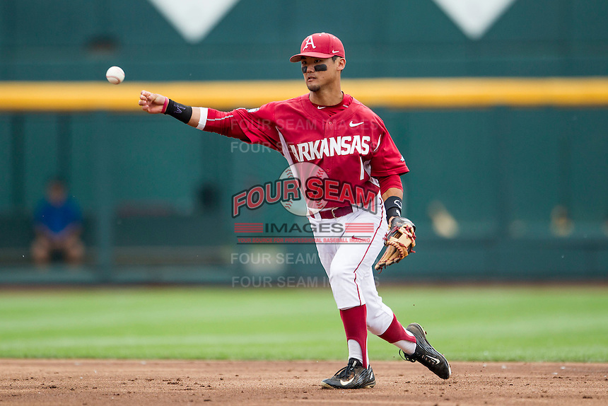 Arkansas Razorbacks second baseman Rick Nomura (1) makes a throw to first base against the Virginia Cavaliers in Game 1 of the NCAA College World Series on June 13, 2015 at TD Ameritrade Park in Omaha, Nebraska. Virginia defeated Arkansas 5-3. (Andrew Woolley/Four Seam Images)