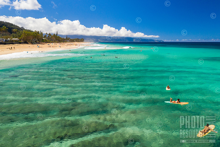 Aerial view of sandbars, surfers and the 'Ehukai coastline in Pupukea along O'ahu's North Shore.
