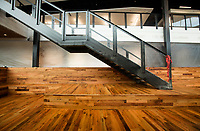 NWA Democrat-Gazette/BEN GOFF @NWABENGOFF<br /> Reclaimed hardwood is used prominently inside the new Tyson Foods buiding Wednesday, Nov. 8, 2017, in downtown Springdale. The nearly complete facility preserves and incorporates two buildings on East Emma Avenue, the former Tyson Foods headquarters and the Brown Hatchery building.