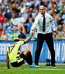 Reading manager Jaap Stam helps up Rajiv van La Parra of Huddersfield Town during the SkyBet Championship Play Off Final match at the Wembley Stadium, England. Picture date: May 29th, 2017.Picture credit should read: Matt McNulty/Sportimage