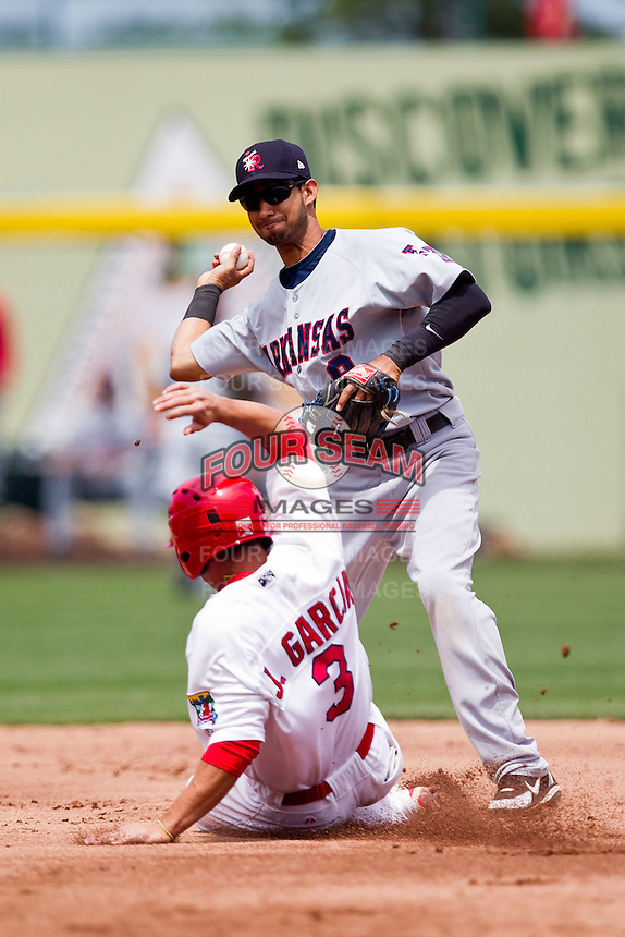 Renny Osuna (9) of the Arkansas Travelers turns a double play during a game against the Springfield Cardinals at Hammons Field on May 8, 2012 in Springfield, Missouri. (David Welker/ Four Seam Images)