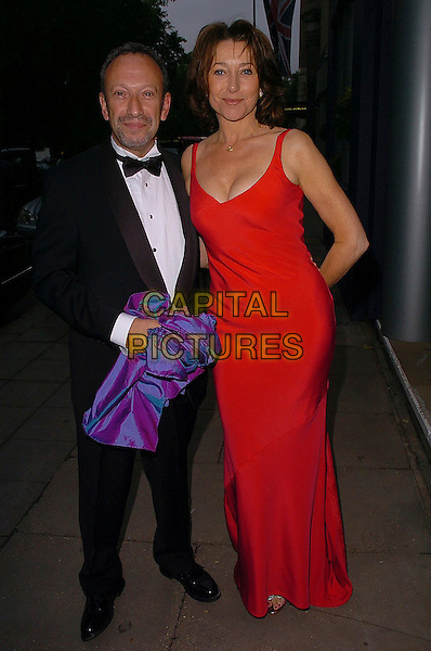 CHERIE LUNGHI & FRIEND.Grosvenor House Arts & Antiques Fair Gala, London..June 16th, 2005.full length tuxedo red dress.www.capitalpictures.com.sales@capitalpictures.com.©Capital Pictures