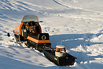 Hauling ice fishing gear with a vintage 1970 AMF Mark V 400 Ski Daddler snowmobile