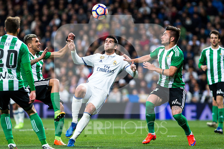 Alvaro Morata competes for the ball with German Pezzella of Real Betis  during the match of Spanish La Liga between Real Madrid and Real Betis at  Santiago Bernabeu Stadium in Madrid, Spain. March 12, 2017. (ALTERPHOTOS / Rodrigo Jimenez)