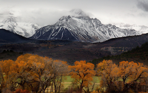 Fresh snow blankets the Rocky Mountains during fall foilage near Telluride, Colorado