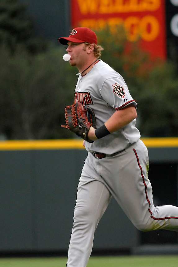 14 August 08: DBacks outfielder Adam Dunn jogs in from the outfield after making the third out of a half inning against the Colorado Rockies. The Arizona Diamondbacks defeated the Colorado Rockies 6-2 at Coors Field in Denver, Colorado. FOR EDITORIAL USE ONLY. FOR EDITORIAL USE ONLY