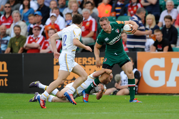 20130809 Copyright onEdition 2013 ©<br /> Free for editorial use image, please credit: onEdition.<br /> <br /> Ollie Turton of Leicester Tigers 7s is tackled by Paul Hodgson of Worcester Warriors 7s during the finals of the J.P. Morgan Asset Management Premiership Rugby 7s Series.<br /> <br /> The J.P. Morgan Asset Management Premiership Rugby 7s Series kicked off for the fourth season on Thursday 1st August with Pool A at Kingsholm, Gloucester with Pool B being played at Franklin's Gardens, Northampton on Friday 2nd August, Pool C at Allianz Park, Saracens home ground, on Saturday 3rd August and the Final being played at The Recreation Ground, Bath on Friday 9th August. The innovative tournament, which involves all 12 Premiership Rugby clubs, offers a fantastic platform for some of the country's finest young athletes to be exposed to the excitement, pressures and skills required to compete at an elite level.<br /> <br /> The 12 Premiership Rugby clubs are divided into three groups for the tournament, with the winner and runner up of each regional event going through to the Final. There are six games each evening, with each match consisting of two 7 minute halves with a 2 minute break at half time.<br /> <br /> For additional images please go to: http://www.w-w-i.com/jp_morgan_premiership_sevens/<br /> <br /> For press contacts contact: Beth Begg at brandRapport on D: +44 (0)20 7932 5813 M: +44 (0)7900 88231 E: BBegg@brand-rapport.com<br /> <br /> If you require a higher resolution image or you have any other onEdition photographic enquiries, please contact onEdition on 0845 900 2 900 or email info@onEdition.com<br /> This image is copyright the onEdition 2013©.<br /> <br /> This image has been supplied by onEdition and must be credited onEdition. The author is asserting his full Moral rights in relation to the publication of this image. Rights for onward transmission of any image or file is not granted or implied. Changing or deleting Copyright information is illeg