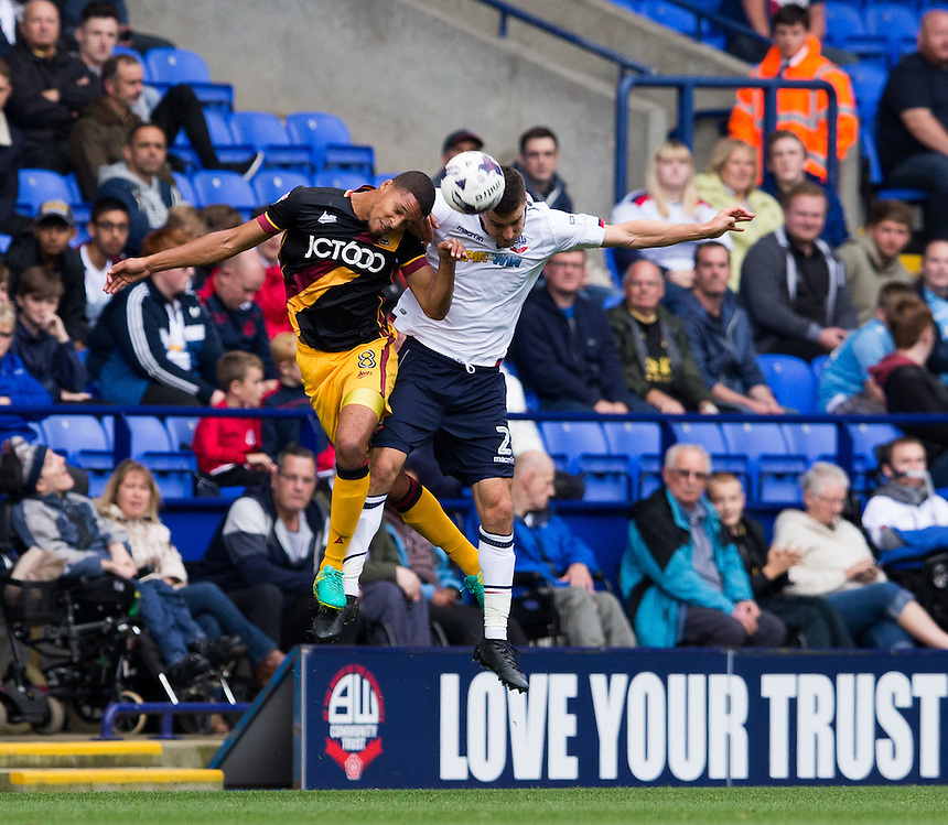 Bolton Wanderers' Lewis Buxton goes up for a header with Bradford City's Timothee Dieng<br /> <br /> Photographer James Williamson/CameraSport<br /> <br /> The EFL Sky Bet League One - Saturday 24th September 2016 - Bolton Wanderers v Bradford City - Macron Stadium - Bolton<br /> <br /> World Copyright &copy; 2016 CameraSport. All rights reserved. 43 Linden Ave. Countesthorpe. Leicester. England. LE8 5PG - Tel: +44 (0) 116 277 4147 - admin@camerasport.com - www.camerasport.com