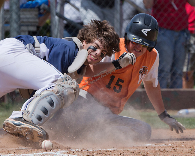 Wells Jake Witte is safe at home as the ball rolls away from Virginia City catcher Dylan Seddon in the championship of the NIAA Division IV State baseball tournament on Saturday, May 24, 2014 at Sparks High School.