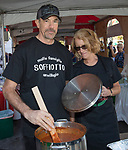 Bert Soffiotto and his sister Anne Marie Smith making sauce during the Italian Festival in downtown Reno on Saturday, Oct. 7, 2017.