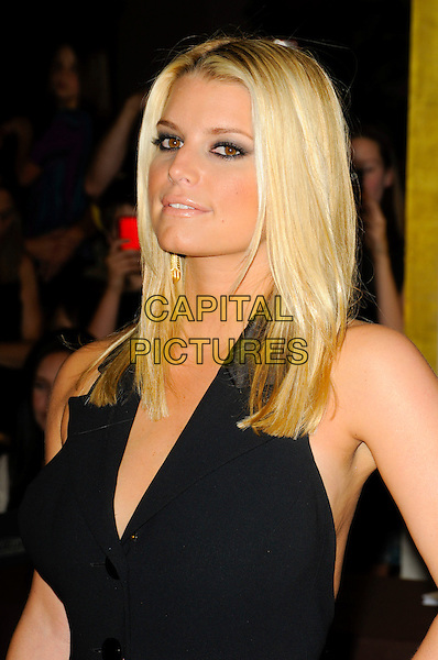 JESSICA SIMPSON.arriving at Operation Smile at the Beverly Hilton Hotel in Beverly Hills, California, USA, October 2nd 2009..portrait headshot halterneck black buttons dyed hair roots make-up eyeliner eyeshadow smoky smokey eyes .CAP/ROT.©Lee Roth/Capital Pictures.