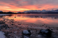 The Kenai Mountains and Skilak Lake await the sun's rise and its imminent warmh duing a frigid morning in Alaska's Kenai National Wildlife Refuge.