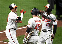 Baltimore Orioles shortstop Manny Machado (13), left, celebrates his second home run of the game with teammates designated hitter Mark Trumbo (45), center, and center fielder Adam Jones (10), right, in the seventh inning of their game against the New York Yankees at Oriole Park at Camden Yards in Baltimore, MD on Tuesday, July 10, 2018.  The Orioles won the game 6 - 5.<br /> Credit: Ron Sachs / CNP<br /> (RESTRICTION: NO New York or New Jersey Newspapers or newspapers within a 75 mile radius of New York City) Credit: Ron Sachs/MediaPunch