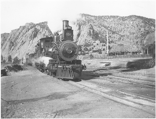 Freight train arriving station.  3-rail track.<br /> D&amp;RG  possibly Texas Creek, CO  ca 1890-1911