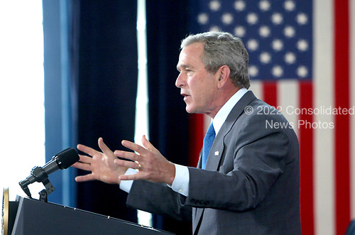 Lusby, MD - June 22, 2005 -- United States President George W. Bush delivers a speech on energy policy and economic security at the Calvert Cliffs Nuclear Energy Plant in Lusby, Maryland on June 22, 2005. <br /> Credit: Dennis Brack - Pool via CNP