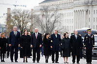 From right, former President George W. Bush, second from right, former first lady Laura Bush, Neil Bush, Sharon Bush, Bobby Koch, Doro Koch, Jeb Bush and Columba Bush, stand just prior to the flag-draped casket of former President George H.W. Bush being carried by a joint services military honor guard from the U.S. Capitol, Wednesday, Dec. 5, 2018, in Washington. <br /> Credit: Alex Brandon / Pool via CNP / MediaPunch