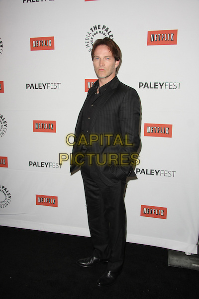 """STEPHEN MOYER .""""True Blood"""" at PaleyFest 2011  Held at The Saban Theater, Beverly Hills, California, USA, 5th March 2011..full length black gray grey pinstripe hand in pocket suit .CAP/ADM/TB.©Tommaso Boddi/AdMedia/Capital Pictures."""