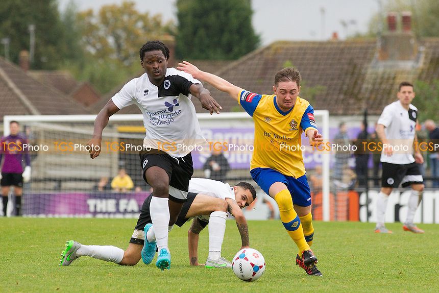 Joey May of AFC Hornchurch fends off the challenge of Clovis Kamdjo of Boreham Wood during Boreham Wood vs AFC Hornchurch, Emirates FA Cup Football at Meadow Park, Borehamwood, England on 24/10/2015