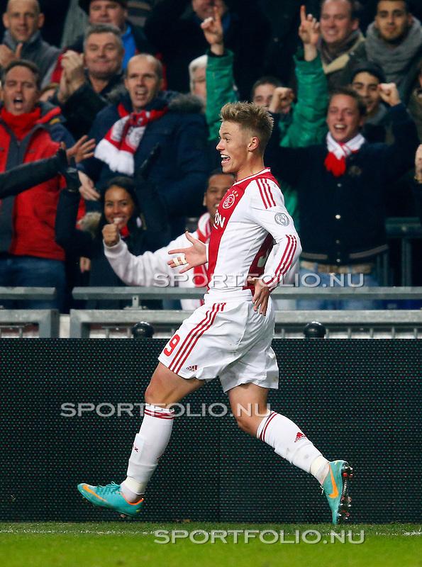 Nederland, Amsterdam, 1 december 2012.Eredivisie.Seizoen 2012-2013.Ajax-PSV (3-1).Viktor Fischer van Ajax juicht nadat hij een doelpunt heeft gemaakt, 3-1