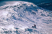 6th January 2018, Praia do Norte, Nazaré , Portugal; Alex Botelho being rescued by a jetski after riding a giant wave in the competition
