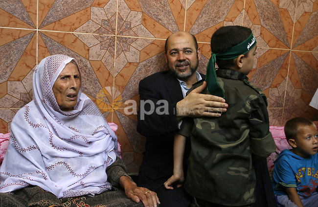 Senior Hamas official, Moussa Abu Marzouk visits the family of Raed Al-Attar in Rafah in southern Gaza strip on August 28, 2014. An open-ended ceasefire in the Gaza war held on Wednesday as Prime Minister Benjamin Netanyahu faced strong criticism in Israel over a costly conflict with Palestinian militants in which no clear victor has emerged. Israel launched an offensive on July 8, with the declared aim of ending rocket fire into its territory. Photo by Abed Rahim Khatib