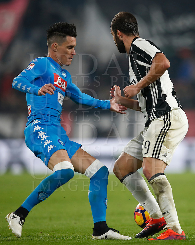 Calcio, Serie A: Juventus Stadium. Torino, Juventus Stadium, 29 ottobre 2016.<br /> Juventus' Gonzalo Higuain, right, is challenged by Napoli's Jose' Maria Callejon during the Italian Serie A football match between Juventus and Napoli at Turin's Juventus Stadium, 29 October 2016. Juventus won 2-1.<br /> UPDATE IMAGES PRESS/Isabella Bonotto