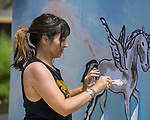Amanda Giacomini paints a mural during Wanderlust at Squaw Valley on Saturday, July 21, 2018.