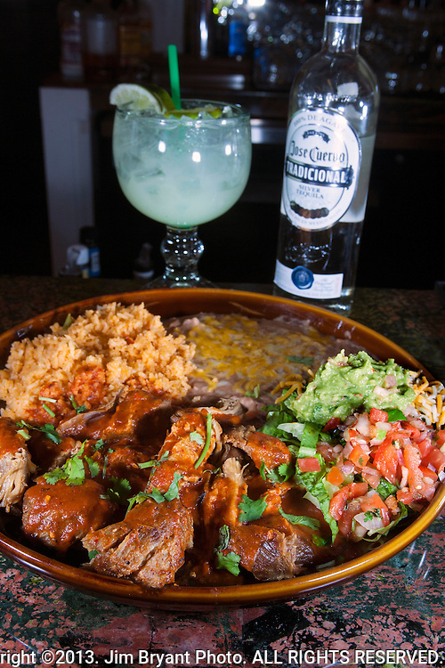 Tequila, Pork Carnitas,  Mexican Rice, refried beans, salsa, onions, green pepper and tequila margarita.  ©2013. Jim Bryant Photo. ALL RIGHTS RESERVED.