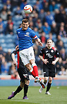 Lee McCulloch wins the ball in the air