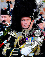 A  pipe band Drum Major from The Gordon Highlanders military pipe band  at The Aboyne Highland GamesRoyal Deeside.<br /> In a military pipe band the Drum Major would be a man of outstanding military character able to control men in battle. The Drum Major was the figurehead of the regiment. In battle he instructed the drummers to play certain beats which passed messages to the rest of the troops.<br /> The Drum Major's was a very important job; if he got it wrong the battle could be lost. He carried proud regimental honours on his sash and upon his silver headed mace.<br /> In more recent years a drum major in a non military band became more of an entertainer who threw and caught his mace. <br /> <br /> www.dsider.co.uk dsider whats on Royal Deeside, photography courses photography by Bill Bagshaw photographers Aboyne