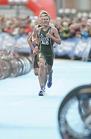 31 AUG 2007 - HAMBURG, GER - Brendan Sexton (AUS) runs through transition at the end of a lap on the run - Under 23 Mens World Triathlon Championships. (PHOTO (C) NIGEL FARROW)