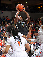 Duke center Elizabeth Williams (1) shoots over Virginia  defenders during an NCAA college basketball game in Charlottesville, Va. Duke defeated Virginia 62-41...