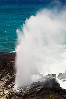 Water spits out of Halona blowhole on the east  shore of Oahu