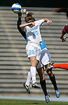 Virginia Tech's Ashley Owens (behind) punches the ball away from North Carolina's Heather O'Reilly (20) on Sunday, October 15th, 2006 at Fetzer Field in Chapel Hill, North Carolina. The University of North Carolina Tarheels defeated the Virginia Tech Hokies 1-0 in an Atlantic Coast Conference NCAA Division I Women's Soccer game.