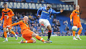 DUNDEE UTD'S GARRY KENNETH CLEARS FROM RANGERS' SONE ALUKO