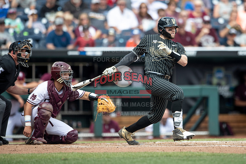 Vanderbilt Commodores catcher Philip Clarke (5) follows through on his swing during Game 8 of the NCAA College World Series against the Mississippi State Bulldogs on June 19, 2019 at TD Ameritrade Park in Omaha, Nebraska. Vanderbilt defeated Mississippi State 6-3. (Andrew Woolley/Four Seam Images)