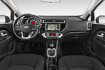 Stock photo of straight dashboard view of2015 KIA Rio World Edition 5 Door Hatchback Dashboard