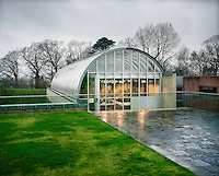 A greenhouse at The Wellcome Trust Millennium Building complex at the Millennium Seed Bank at Wakehurst Place in West Sussex. The building houses facilities for seed-preparation, laboratories and public exhibitions. There is a large storage vault which lies underneath the building. The Millennium Seed Bank Partnership is coordinated by Kew Gardens and aims to collect seeds from every wild plant in the world to insure against extinction. It reached its target of banking seeds from all of the UK's native plant species as well as banking 10% of the world's wild plant species in 2009, and aims to have 25% by 2020.