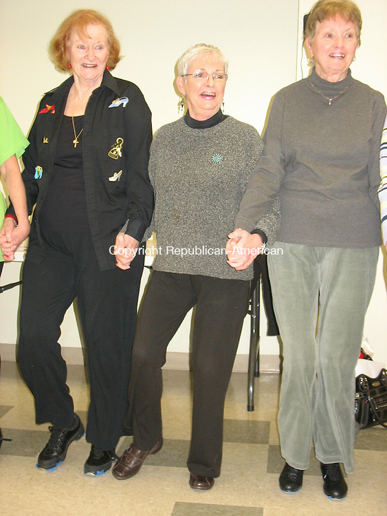 SOUTHBURY, CT. - 30 Dec. 2009 - 123009CG01 - Carole Damon, center, tap dances Wednesday with members of the Tap Dancing Club at the Southbury Senior Center. Damon, the center's director, will retire Jan. 6. Chris Gardner Republican-American
