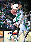North Texas Mean Green guard Tristan Thompson (14) gets the rebound in the game between the Texas State Bobcats and the University of North Texas Mean Green at the North Texas Coliseum,the Super Pit, in Denton, Texas. UNT defeated Texas State 85 to 62