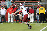 Zach Charme, Washington State University punter, punts in the rain during the Cougars first road test of the season against Big Ten foe Rutgers at High Point Solutions Stadium in Piscataway, New Jersey, on September 12, 2015.  WSU came back from a late deficit to go on a 90 yard touchdown drive to score the winning TD with 13 seconds left to get the win, 37-34.