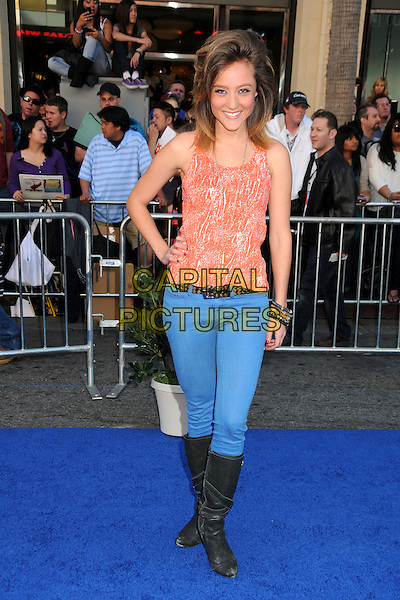 "LAUREN C. MAYHEW .Attending the ""Gnomeo and Juliet"" World Premiere held at the El Capitan Theatre, Hollywood, California, USA, .23rd January 2011..& arrivals full  length blue jeans black knee high boots belt hand  on hip orange vest top .CAP/ADM/BP.©Byron Purvis/AdMedia/Capital Pictures."